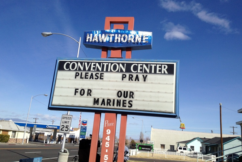 A Convention Center billboard asks people to pray for the Marines that will killed in Hawthorne, Nev. on Tuesday March 19, 2013. Military officials say a mortar shell explosion killed seven Marines and injured a half-dozen more during a training exercise in Nevada's high desert. The accident prompted the Marine Corps to immediately halt use of some mortar shells until an investigation can determine its safety. (AP Photo/The Reno Gazette-Journal, Marilyn Newton)