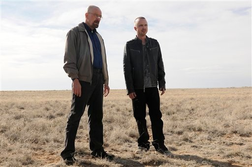 """This image released by AMC shows Bryan Cranston as Walter White, left, and Aaron Paul as Jesse Pinkman in a scene from the season 5 premiere of """"Breaking Bad."""""""