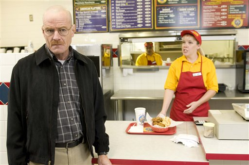 """This image released by AMC shows Bryan Cranston as Walter White at the fictional restaurant """"Los Pollos Hermanos"""" in a scene from season 2 of the AMC series """"Breaking Bad."""" A Twisters burrito restaurant in Albuquerque that serves as the location for the restaurant has become an international tourist attraction."""