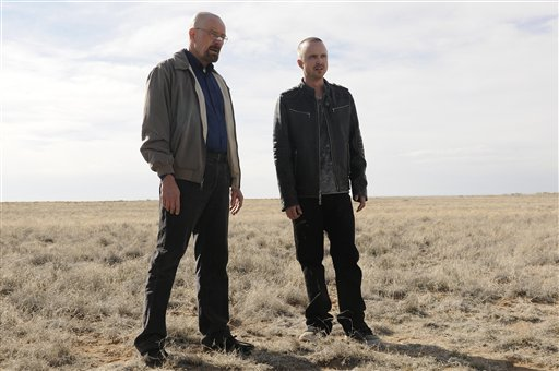 "This image released by AMC shows Bryan Cranston as Walter White, left, and Aaron Paul as Jesse Pinkman in a scene from the season 5 premiere of ""Breaking Bad."""