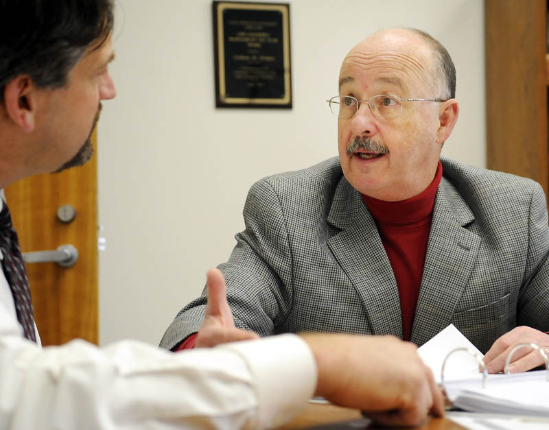 Augusta City Manager William Bridgeo, right, discusses the city's 2012 budget with former Development Director Michael Duguay at the manager's Augusta office on March 28, 2012. Duguay left city employment in November, taking a job with Summit Utilities.