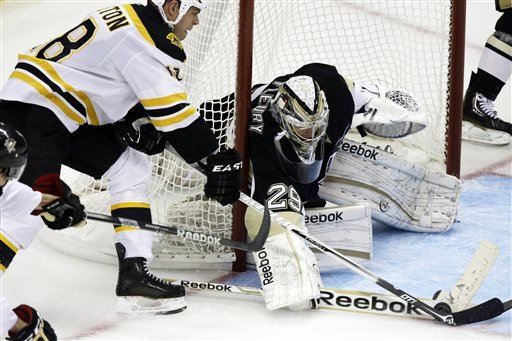 Boston Bruins right wing Nathan Horton (18) can't get the puck past Pittsburgh Penguins goalie Marc-Andre Fleury (29) in the third period of an NHL hockey game in Pittsburgh Tuesday, March 12, 2013. The Penguins won 3-2. (AP Photo/Gene J. Puskar)