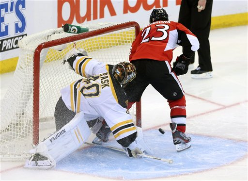 Boston Bruins goaltender Tuukka Rask(40) looks on as Ottawa Senator Kaspars Daugavins attempts an unconventional way of shooting the puck with the tip of his stick during a shoot out and in Ottawa Monday March 11, 2013. Boston beat Ottawa 3-2. (AP Photo/The Canadian Press, Fred Chartrand) action;athlete;athletic;athletics;Canada;Canadian;compete;competition;competitive;cppixottawa Canada;game;hockey;ice hockey;League;National;NHL;play;sports