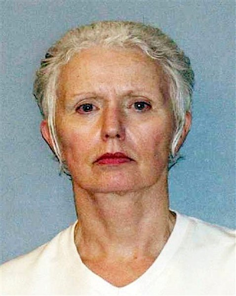 This undated file photo provided by the U.S. Marshals Service shows Catherine Greig, the longtime girlfriend of Whitey Bulger, captured with Bulger June 22, 2011, in Santa Monica, Calif. Greig was by Bulger's side for more than three decades, first as a secret girlfriend he kept on the side while he lived with another woman, then as the faithful woman who left behind her life in Massachusetts so she could go on the run with him.