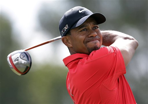 Tiger Woods hits from the third tee during the third round of the Cadillac Championship golf tournament Sunday in Doral, Fla. WGC-Cadillac World Golf Champioship