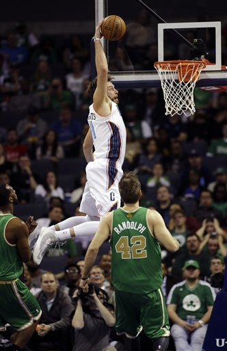 Charlotte Bobcats' Josh McRoberts grabs a high pass for a dunk against the Boston Celtics during the second half of an NBA basketball game in Charlotte, N.C., Tuesday, March 12, 2013. The Bobcats won 100-74. (AP Photo/Bob Leverone)