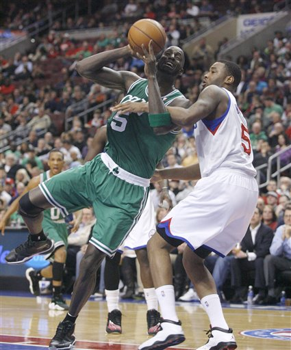 Boston Celtics' Kevin Garnett ,left drives against Philadelphia 76ers' Arnett Moultrie (5) in the first half of an NBA basketball game, Tuesday, March 5, 2013, in Philadelphia. (AP Photo/H. Rumph Jr)