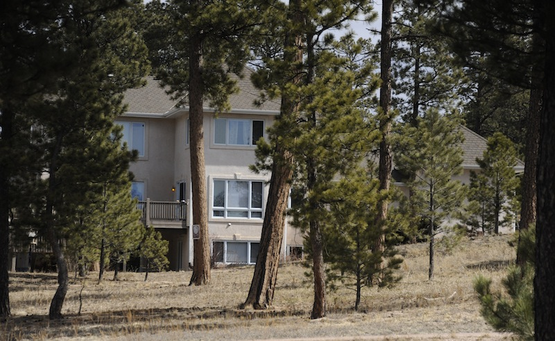 The wooded home in Monument, Colo., of Colorado Department of Corrections director Tom Clements is seen on Wednesday, March 20, 2013. Clements was shot to death Tuesday night when he answered the front door. (AP Photo/The Colorado Springs Gazette, Mark Reis) MARK REIS;fatal shooting;TOM CLEMENTS;DEPARTMENT OF CORRECTIONS;HOMICIDE