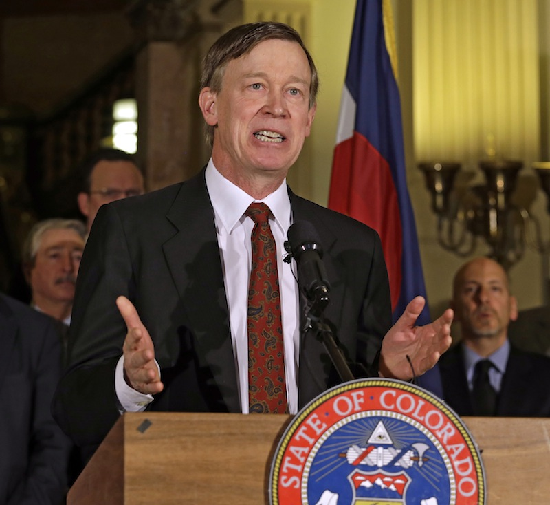 Colorado Gov. John Hickenlooper speaks at a news conference at the Capitol in Denver on Wednesday, March 20, 2013, where he talks about the shooting death of Tom Clements, the executive director of the Department of Corrections, who was shot and killed when he answered the front door of his house Tuesday night, in Monument, Colo. Police are searching for the gunman and trying to figure out if the attack had anything to do with his position. (AP Photo/Ed Andrieski)