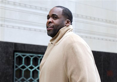 Former Detroit Mayor Kwame Kilpatrick makes his way to federal court in Detroit on Monday.