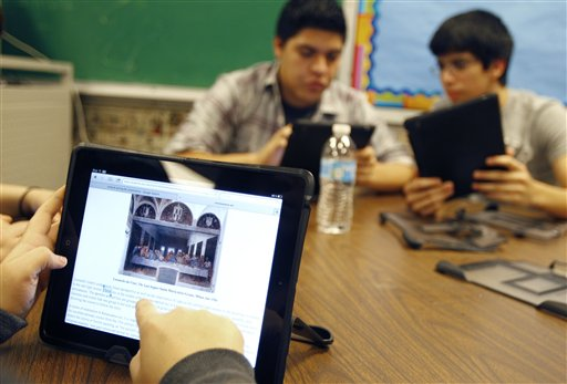 """Ysabella Ortegon, 16, reads about Leonardo da Vinci's painting """"The Last Supper"""" while working on her iPad at McAllen Memorial High School in McAllen, Texas, recently."""