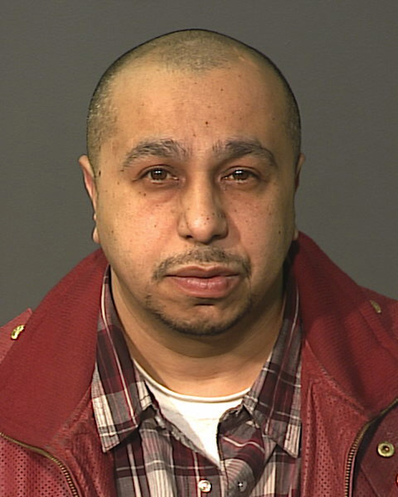This undated photo, provided by the New York City Police Department on Monday March 4, 2013, shows Julio Acevedo, 44, who police are looking for in connection with the death of an expectant couple that was killed in a car crash in Brooklyn early Sunday morning and their premature baby, who was delivered alive but did not survive. (AP Photo/NYPD)