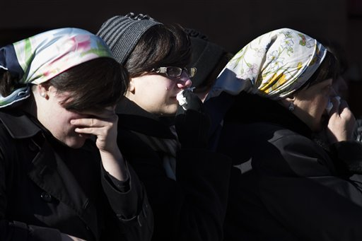 Members of the Satmar Orthodox Jewish community grieve at the funeral of two expectant parents who were killed in a car accident, Sunday, March 3, 2013, in the Brooklyn borough of New York. A driver struck the car early Sunday morning, killing both parents while their baby, who was born prematurely, survived and is in critical condition. (AP Photo/John Minchillo)