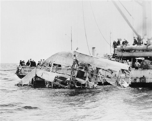 In this April 23, 1933 file photograph, the wreckage of the naval dirigible USS Akron is brought to the surface of the ocean off the coast of New Jersey. The Akron went down in a violent storm off the New Jersey coast. The disaster claimed 73 lives, more than twice as many as the crash of the Hindenburg, four years later. The USS Akron, a 785-foot dirigible, was in its third year of flight when a violent storm sent it crashing tail-first into the Atlantic Ocean shortly after midnight on April 4, 1933.
