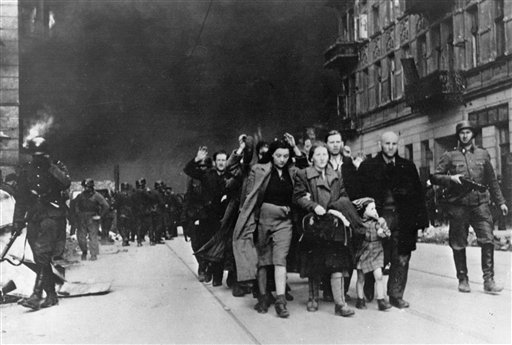 In this in April/May 1943 file photo, a group of Polish Jews are led away for deportation by German SS soldiers during the destruction of the Warsaw ghetto by German troops after an uprising in the Jewish quarter. U.S. gun rights advocates pointing to the 1943 Warsaw ghetto uprising by about 700 armed Jews who were able to fend off a much larger force of German troops for days until retreating to tunnels or fleeing.