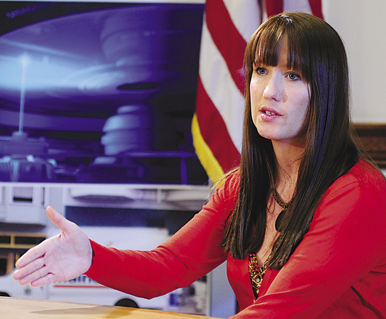 Adrienne Bennett, Gov. Paul LePage's press secretary, answers questions during a news conference on Friday March 1, at the State House in Augusta.