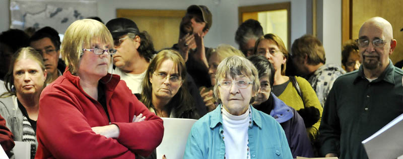 END OF TERM: Ann Chadwick, center in blue, says she was terminated as town clerk Wednesday March 6, 2013 in Pittston by the selectmen.