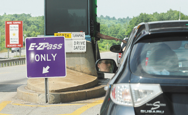 Motorists in the northbound lane of I-295 enter the Gardiner toll station on Monday.