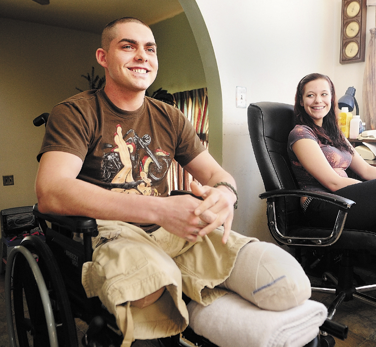 Jeremy Gilley, left, and his girlfriend, Rachael Turcotte, answer questions during an interview at his parent's home in Palermo.
