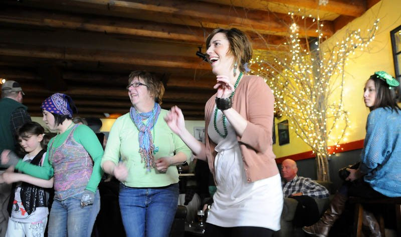 Folks dance to a band Sunday at Higher Grounds in Hallowell during St. Patrick's Day festivities.