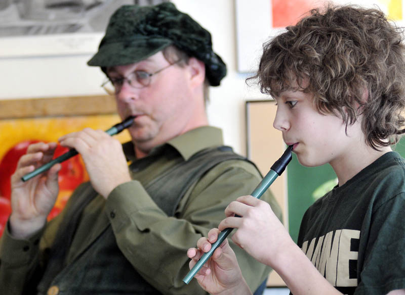 Adam Soosman, left, and Will Fahy, 13, play tin whistles Sunday at the Harlow Gallery in Hallowell. The duo played traditional Irish songs on the instruments during a fundraiser at the gallery on Saint Patrick's Day.