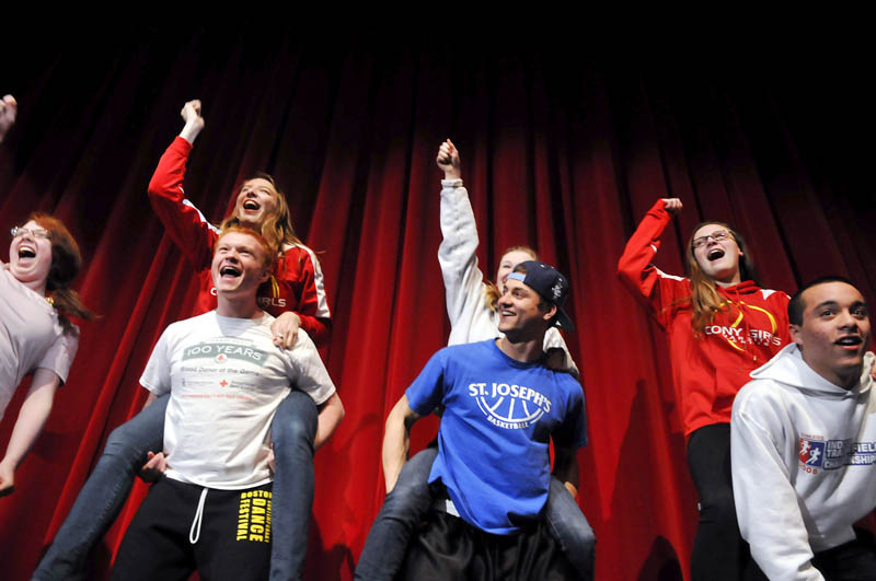 """Cony High School students rehearse Wednesday for the 122nd Chizzle Wizzle at the Augusta school. Featuring a 1980s theme and titled """"Rock of Stages,"""" the annual performance by Cony students runs March 19-22. Tickets are available at the high school."""