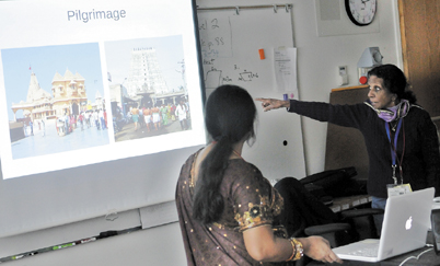 Pushpa Harding, right, and Janaki Shanmugam, left, explain the finer points of Hinduism to a sixth-grade class during an interfaith program at Messalonskee Middle School in Oakland on Friday. The event allowed students to listen to different religious perspectives and included speakers on Christianity, Judaism, Hinduism, Islam and paganism.
