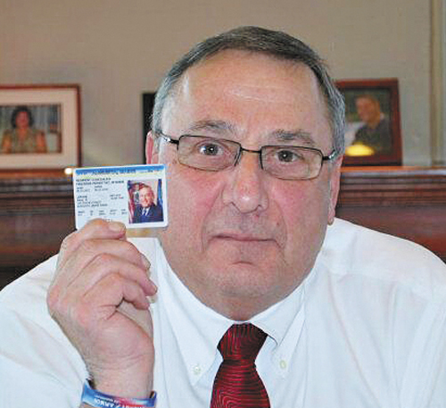 """Gov. Paul LePage displays his concealed-carry permit in a photo posted to his Twitter account. """"If newspapers want to know who has concealed weapons permits, they should know I do,"""" LePage tweeted."""