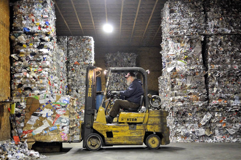 Ron Slatermanager of the Sandy River Recycling Association loads a 1-ton pallet of cardboard onto the scale in the storage area in Farmington on Thursday.