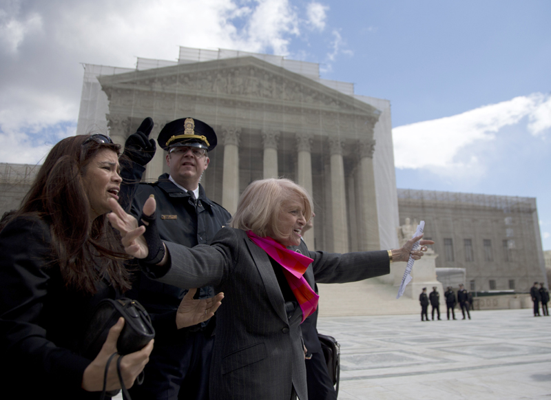Plaintiff Edith Windsor of New York waves to supporters in front of the Supreme Court in Washington, Wednesday, after the court heard arguments on the Defense of Marriage Act (DOMA) case.