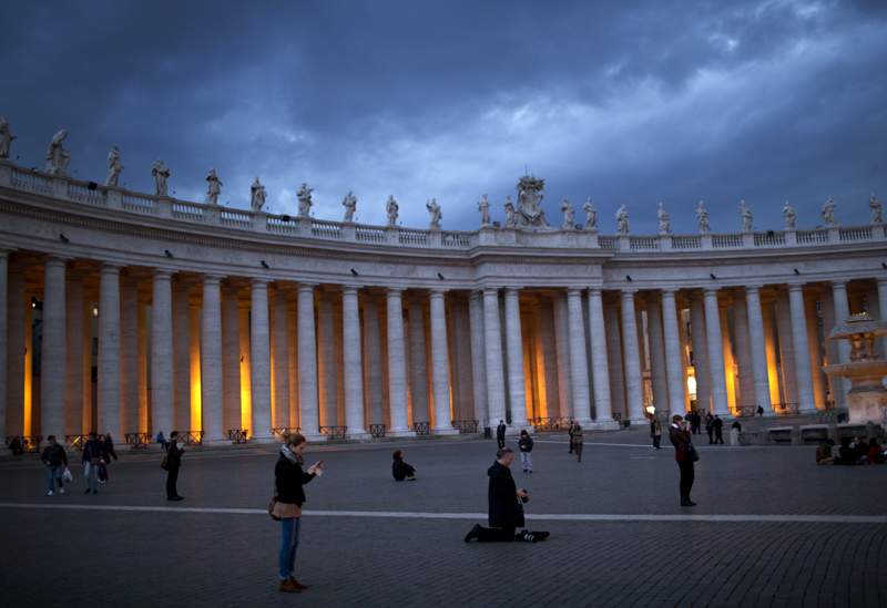 Faithful are seen in St. Peter's Square, at the Vatican, Monday. Cardinals have gathered for their final day of talks before the conclave to elect the next pope amid debate over whether the Catholic Church needs a manager pope to clean up the Vatican's messy bureaucracy or a pastoral pope who can inspire the faithful and make Catholicism relevant again.
