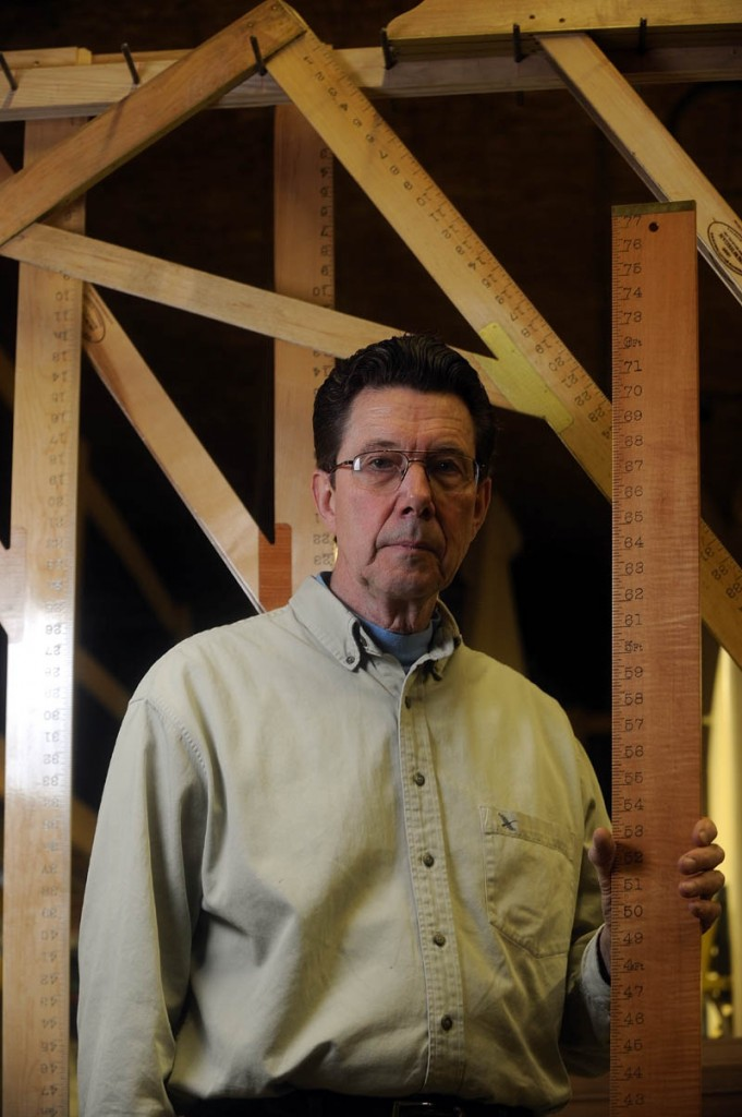 Steve Meisner, owner of Wooden Rule, Co., stands with a height measuring ruler, with one-of-a-kind L-squares that are made exclusively by Wooden Rule, Co., in East Madison.