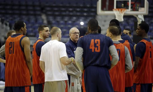 Syracuse head coach Jim Boeheim, center, talks with his players at the end of practice for a regional semifinal game in the NCAA college basketball tournament, Wednesday, March 27, 2013, in Washington. Syracuse plays Indiana on Thursday. (AP Photo/Pablo Martinez Monsivais)