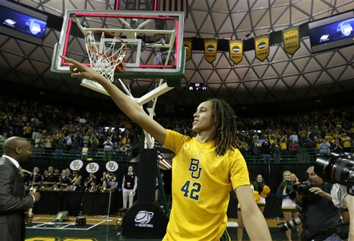 Baylor's Brittney Griner (42) acknowledges cheers from fans as she leaves the court following their second-round game against Florida State in the women's NCAA college basketball tournament Tuesday, March 26, 2013, in Waco, Texas. Baylor won 85-47. (AP Photo/Tony Gutierrez)