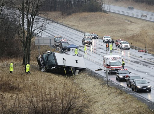 Law enforcement personnel work at the scene of a bus crash on the Adirondack Northway on Tuesday in Clifton Park, N.Y.