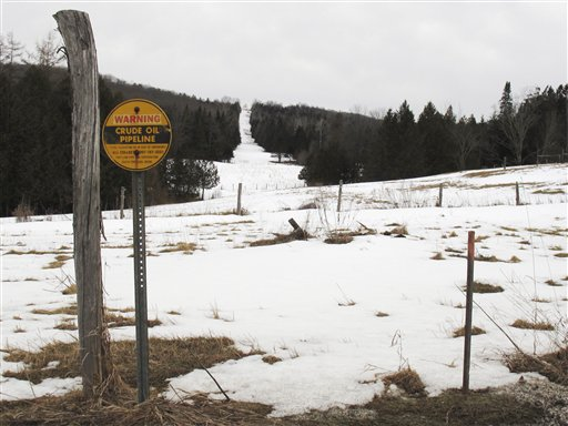 In this March 11 photo, a sign indicates a section of a buried crude oil pipeline in Burke, Vt. Canadian energy officials insist they have no plans to reverse the flow of the pipeline that now carries crude oil from Maine to Montreal, but that has done little to reassure New England towns that are against the idea and the 18 members of Congress asking for a full environmental review.