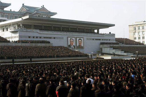 North Koreans attend a rally in Kim Il Sung Square in Pyongyang, North Korea, on Thursday. North Korea on Thursday amplified its threatening rhetoric hours ahead of a vote by U.N. diplomats on whether to level new sanctions against Pyongyang for its recent nuclear test.