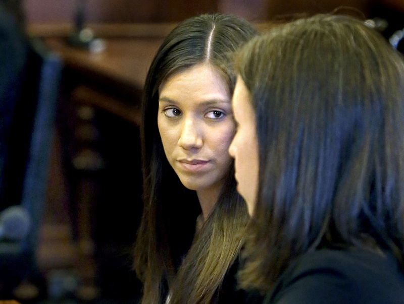 Alexis Wright, left, listens to her lawyer Sarah Churchill during her arraignment. While Wright has been charged with prostitution, her former Zumba fitness studio is expected to reopen under new management.