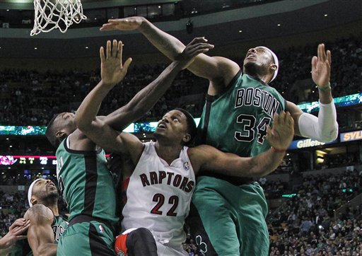 Toronto Raptors forward Rudy Gay (22) fights for position under the basket between Boston Celtics forwards Paul Pierce (34) and Jeff Green, left, during the second half of an NBA basketball game against the Toronto Raptors in Boston, Wednesday, March 13, 2013. The Celtics won 112-88. (AP Photo/Elise Amendola)