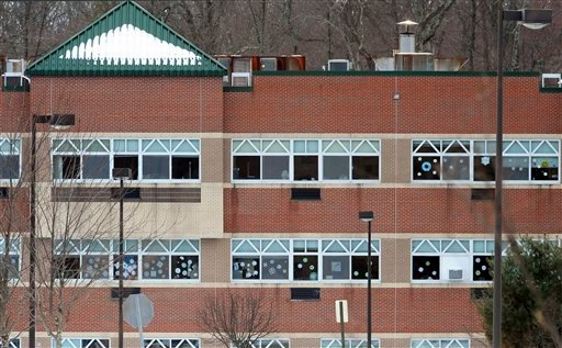 Snowflake artwork adorns windows at the new Sandy Hook Elementary School. Three months after the Newtown massacre, children and teachers who survived remain on edge.
