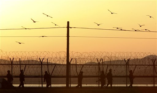 South Korean army soldiers patrol along a barbed-wire fence near the border village of Panmunjom in Paju, South Korea, on Tuesday evening.