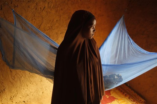 Zali Idy, 12, poses in her bedroom in the remote village of Hawkantaki, Niger, on July 18, 2012. Zali was married in 2011. One third and more of all girls are married in 42 countries, according to the U.N. Population Fund, referring to females under the age of 18. The highest number of cases occurs in some of the poorest countries, the agency figures show, with the West African nation of Niger bottom of the list, with 75 percent of girls married before they turn 18.