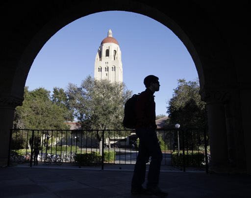 A Stanford University student walks in front of Hoover Tower on campus in Palo Alto, Calif., in this 2012 photo, Congressional inaction could end up costing college students an extra $5,000 on their new loans.