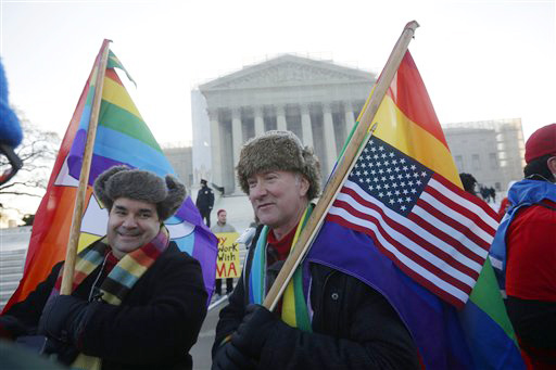 Marcus, left, and Daniel German-Dominguez stand outside the Supreme Court in Washington on Tuesday, before the court's hearing on California's voter-approved ban on same-sex marriage.