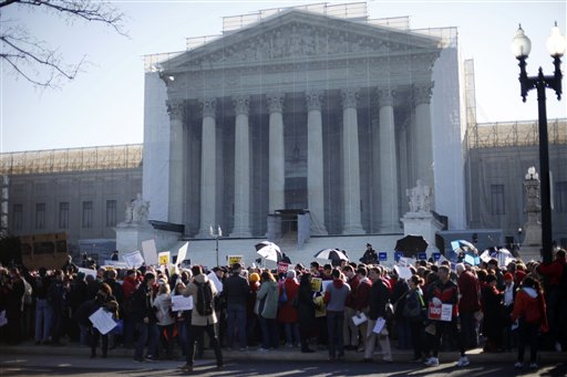 Demonstrators crowd the sidewalk outside the Supreme Court in Washington on Tuesday.