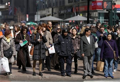 In this photo taken Wednesday, pedestrians wait to cross a New York street. An historic decline in the number of U.S. whites and the fast growth of Latinos are blurring traditional black-white color lines in the U.S. The demographic shift is now a potent backdrop to an immigration overhaul bill, being debated in Congress, that could offer a path to citizenship for 11 million mostly Hispanic illegal immigrants.