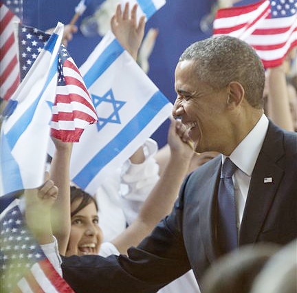 President Barack Obama is greeted by children waving Israeli and American flags as he arrives at the residence of Israeli President Shimon Peres on Wednesday in Jerusalem.