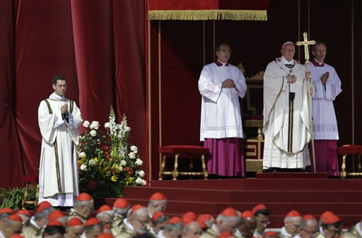 Pope Francis stands at the steps of St. Peter's Basilica during his inaugural Mass in St. Peter's Square at the Vatican on Tuesday.