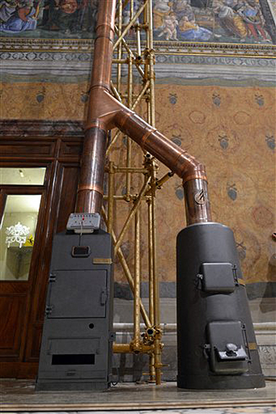This photo provided by the Vatican newspaper L'Osservatore Romano on Friday shows the stoves inside the Sistine Chapel at the Vatican where the ballots will be burned during the conclave.