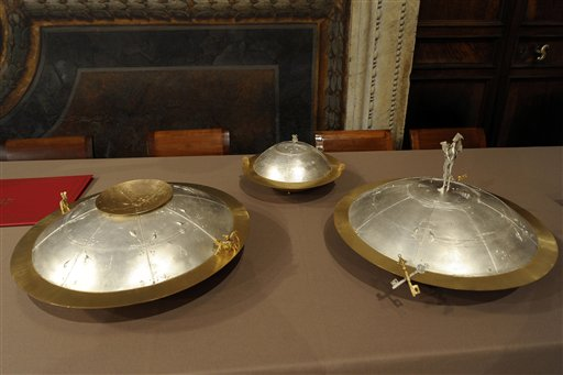 This picture made available by the Vatican newspaper L'Osservatore Romano shows the urns where each cardinal will place his folded ballot after voting inside the Sistine Chapel during the conclave at the Vatican.